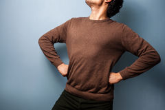 Young man is standing in a proud stance Stock Photography
