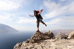 Young man standing on a rock Royalty Free Stock Photography