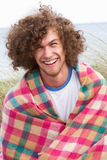 Young Man Standing In Sand Dunes. Wrapped In Blanket Royalty Free Stock Photography