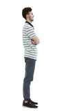 Young man standing sideways isolated on white background Royalty Free Stock Images
