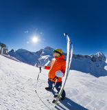 Young man standing with ski near in snow Stock Photography