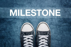 Young man standing on the street, milestone marking on road Stock Photography