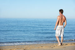 Young Man Standing On Summer Beach Royalty Free Stock Image