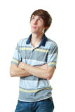 Young man standing thinkikn Stock Image