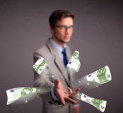 Young man standing and throwing money Royalty Free Stock Photo