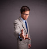 Young man standing and throwing something Stock Photo