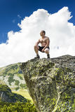 Young man standing on top of a cliff Royalty Free Stock Photo
