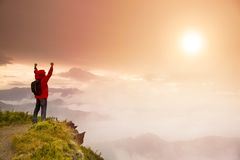 Young man  standing  on top of  mountain Stock Photo