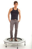 Young man standing on trampoline Stock Photo