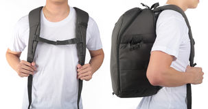 Young man standing with travel backpack equipments isolated whit Stock Photography