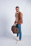 Young man standing with travel bag Stock Photos