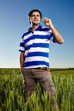 Young man standing in a wheat field Royalty Free Stock Photos