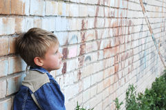 Young man stands against graffiti Stock Images