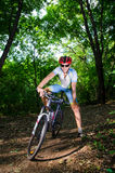 Young man stands with bike and smiles Royalty Free Stock Photo