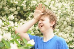 Young man stands among the flowers and enjoys summer and flowering stock photos