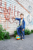 Young man stands  graffiti. Young man stands against graffiti Stock Photo