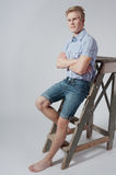 Young man stands near the ladder Royalty Free Stock Photography