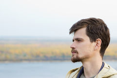 A young man stands outdoor. royalty free stock image