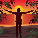 Man stands at sunset with open arms outstretched Stock Images