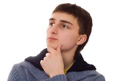 Young man stands and thinks on a white background Stock Image