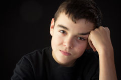 A Young Man Stares at the Viewer Royalty Free Stock Photography