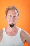 Young man staring. Unhappy and cranky man with a goatee Royalty Free Stock Image
