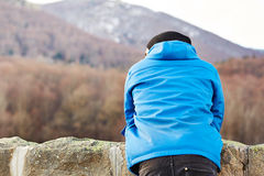 Young man staring at winter landscape Stock Image