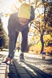 Young man in start ready for run. Autumn season. Stock Photography