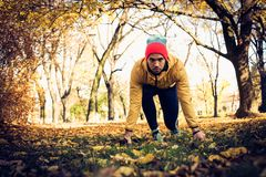 Young man start run. Looking at camera. One man only in park Royalty Free Stock Photography
