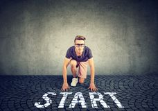 Young handsome man in the starting position Royalty Free Stock Photo