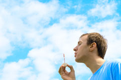 The young man starts up soap bubbles Royalty Free Stock Photos