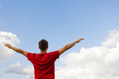 Young man staying with raised hands Stock Image