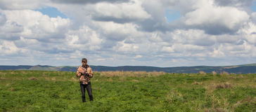 Young man at the steppe, Kazakhstan Stock Photography