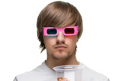 Young man in stereo glasses. With popcorn stock images