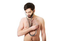 Young man with stethoscope. Stock Photos