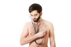 Young man with stethoscope. Stock Images