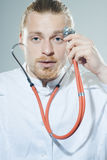 Young man with stethoscope Royalty Free Stock Photography