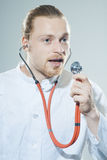 Young man with stethoscope stock photos
