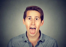 Young man sticking out his tongue. Portrait of young man sticking out his tongue Stock Photography