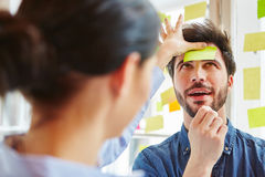 Young man with sticky note on forehead Stock Photo