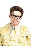 Young man with a sticky note on his face Stock Images