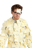 Young man with a sticky note on his face, covered with yellow stickers Royalty Free Stock Image