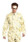Young man with a sticky note on his face, covered with yellow stickers Stock Image