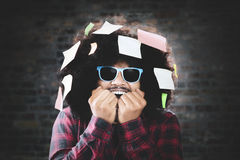 Young man with sticky notes over head Royalty Free Stock Photography