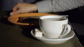Young man stirring tea with spoon. HD stock video