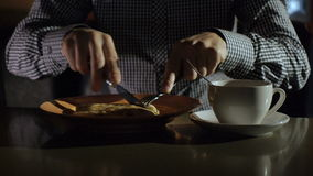 Young man stirring tea with spoon. HD stock footage
