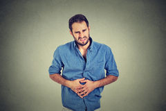 Young man with stomach pain Stock Photos
