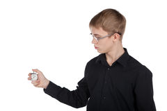 Young man with a stopwatch in hand Royalty Free Stock Images