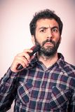 Young man with strage expression when cut his beard and moustach Royalty Free Stock Photos