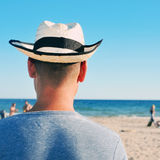 young man with a straw hat on the beach Stock Photo